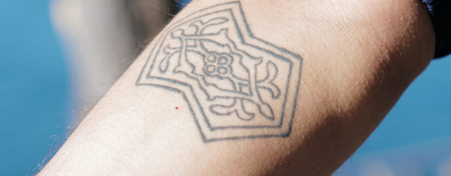 Athreya's right arm bears a tattoo of his favorite translation surface — a double pentagon. (Radhika Govindrajan)
