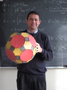 Photo of Jesús De Loera with a polytope.