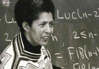 Gloria Hewitt at a blackboard while teaching at University of Montana